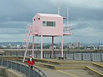 The Pink Hut, Cardiff Barrage Situated on the breakwater on the seaward side of the Cardiff Barrage, the Pink Hut is used by local yacht clubs to start and control races in the estuary.