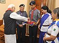 The cadets of Bharat Scouts and Guides collecting funds from the Vice President, Shri Mohd. Hamid Ansari, on the occasion of Bharat Scouts & Guides Flag Day, in New Delhi on November 10, 2014.jpg