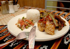 Cuisine of East Timor - An East Timorese dish of ikan sabuko with batar daan, rice and budu.