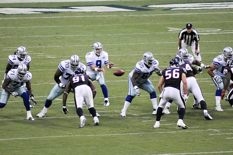 File:Tony Romo taking the ball from shotgun.jpg