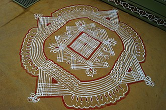 Kolam - Traditional kolam made with rice flour and kaavi borders, made for a festival season at Tamil Nadu, India