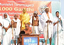 Trainer, motivator, author & keynote speaker ujjwal patni becomes mahatma gandhi and for 1000 gandhi event at sabarmati, ahmedabad, india with blessings of Muni Shri Tarunsagar ji, Guinness record event, october 2012.jpg
