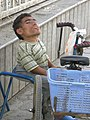 Tricycle Rider dwarf man 1.jpg
