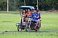 Tuk-tuk taxi sidecar in Laos.jpg