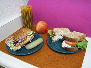 Two sandwiches; on the left a Subway club, on ...
