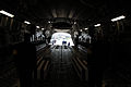 U.S. Airmen, assigned to the 51st Fighter Wing Honor Guard, place transfer cases containing the remains of U.S. Soldiers killed during the Korean War inside a C-17 Globemaster III aircraft at the 51st Fighter 070412-F-IF940-115.jpg