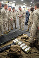 U.S. Marine Corps Brig. Gen. Charles G. Chiarotti, center right, the deputy commanding general of U.S. Marine Forces Africa, discusses the contents of a Mojo medical bag with Navy Senior Chief Petty Officer 120416-A-XJ577-132.jpg
