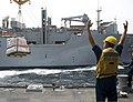 U.S. Navy Boatswain's Mate 3rd Class Dylan Steffan, assigned to the guided missile destroyer USS William P. Lawrence (DDG 110), directs cargo during an underway replenishment with the dry cargo 130713-N-ZQ631-208.jpg