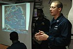 U.S. Navy Cryptologic Technician (Maintenance) Adam Skretch, right, discusses the Battle of Midway during a presentation aboard the guided missile destroyer USS Curtis Wilbur (DDG 54) during Cooperation Afloat 130607-N-AX577-529.jpg