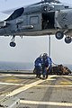 U.S. Navy Gunner's Mate 3rd Class Antonio Sanchez and Seaman Donald Bourne-Kaluhiwa clear the flight deck after attaching a hook to an SH-60B Seahawk helicopter assigned to Helicopter Anti-Submarine Squadron 130611-N-QL471-593.jpg