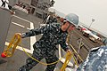 U.S. Navy Logistics Specialist 3rd Class Corley Miller prepares to throw a heaving line as the guided missile destroyer USS Wayne E. Meyer (DDG 108) arrives in Manilia, Philippines, Jan. 29, 2012 120129-OH194-001.jpg