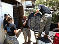 U.S. Soldiers with the 8th Sustainment Command, the Tripler Army Medical Center, and the 25th Infantry Division, unload appliances from a church in Eva Beach to an emergency bed house, during the Soldier for 130611-A-KH515-592.jpg