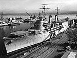 USNS Corpus Christi Bay (T-ARVH-1) at the Charleston Naval Shipyard, South Carolina (USA), in 1966 (NH 99782).jpg