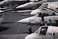US Navy 030404-N-0050T-005 A Plane Captain assigned to the 'Tomcatters' of Fighter Squadron Thirty One (VF-31) wipes down the cockpit canopy of an F-14D Tomcat aboard USS Abraham Lincoln (CVN 72).jpg