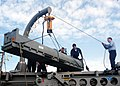 US Navy 030625-N-1512S-799 Fire Control Technicians move a missile during preparations to return from deployment aboard USS Kearsarge (LHD 3).jpg
