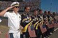 US Navy 031018-N-8629D-111 Commander Navy Recruiting Command, Adm. Jeff Fowler, and the Navy NASCAR Busch Series Racing Team pit crew honor the national ensign during the national anthem.jpg