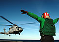 US Navy 040308-N-8704K-002 A Landing Signal Enlisted (LSE) signals an SH-60F Seahawk assigned to the.jpg