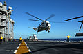 US Navy 040628-N-6932B-087 A UH-3H Sea King helicopter takes off from the flight deck of the amphibious assault ship USS Tarawa (LHA 1).jpg