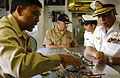 US Navy 040727-N-8148A-017 Aircraft handler, Cmdr. Joe Amper (left), of Manilla, Philippines gives an explanation of aircraft icons.jpg