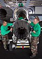 US Navy 041116-N-4166B-048 Sailors perform maintenance on an F-414-GE-400 jet engine used in an F-A-18E Super Hornet in hangar bay aboard the Nimitz-class aircraft carrier USS Abraham Lincoln (CVN 72).jpg