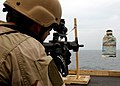 US Navy 041116-N-5345W-153 Hull Maintenance Technician 2nd Class Aaron Edmonds assigned to Explosive Ordnance Disposal Mobile Unit Six (EODMU-6), Detachment Ten, sights his target through the scope of his M4-A1 assault rifle.jpg