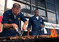 US Navy 050917-N-7202W-017 USS Iwo Jima (LHD 7) Commanding Officer, Capt. Richard S. Callas, left, mans one of the several grills for relief workers in downtown New Orleans during hurricane relief efforts.jpg