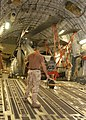 US Navy 051015-N-5863B-003 U.S. Navy helicopter loaded onto transport aircraft bound for Pakistan earthquake relief efforts.jpg