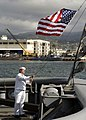 US Navy 070112-N-4400J-062 A Sailor assigned to Military Sealift Command (MSC) raises the ensign for the first time aboard newly recommissioned USNS Salvor.jpg
