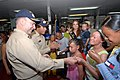 US Navy 070820-N-8704K-067 Capt. Bob Kapcio, mission commander for Military Sealift Command hospital ship USNS Comfort (T-AH 20), gives mission coins to children with genetic skin disorders from the Miss Ecuador Foundation as V.jpg