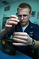 US Navy 080212-N-5821P-006 Aircrew Survival Equipmentman 2nd Class Brock Riggen rebuilds an oxygen regulator in the aircraft intermediate maintenance department at Naval Air Station Sigonella.jpg