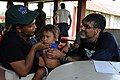 US Navy 080820-N-7955L-062 Project HOPE volunteer Dale Rai uses a stethoscope to examine a child.jpg