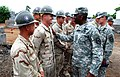 US Navy 090123-N-1540F-008 Gen. William E. Ward and Command Sgt. Maj. Mark Ripka meets Seabees who are building a six-classroom schoolhouse as part of humanitarian civic assistance project.jpg