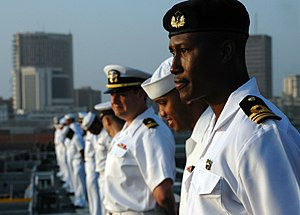 US Navy 090204-N-1655H-077 Ghana Navy Lt. Cmdr. James Agambiere mans the rails aboard the flight deck of the amphibious transport dock ship USS Nashville (LPD 13).jpg