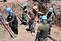 US Navy 090406-M-2727G-001 Armed Forces of the Philippines Air Force engineers and Seabees assigned to Naval Mobile Construction Battalion (NMCB) 40 survey the construction site where a new water well system.jpg