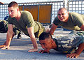US Navy 090627-N-5207L-045 Marines assigned to the 24th Marine Regiment and soldiers from the 9th Royal Malay Regiment conduct physical training aboard the amphibious dock landing ship USS Harpers Ferry (LSD 49).jpg