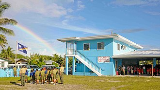 Delap-Uliga-Djarrit - Students at the Majuro Cooperative School raise the Republic of Marshall Islands flag at a ceremony during a Pacific Partnership 2009 community service project