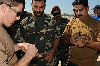 Special Service Group (Navy) - Image: US Navy 091012 N 0260R 076 Pakistani navy sailors listen as Explosive Ordnance Disposal Technician 1st Class Mark Peters