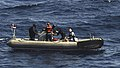 US Navy 091117-N-9500T-312 The last of three men that were clinging to a piece of wood in the Gulf of Aden is helped aboard a rigid hull inflatable boat.jpg