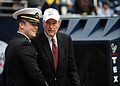 US Navy 091231-N-3879H-038 Midshipman 1st Class Aaron Stroud, a senior at the U.S. Naval Academy, speaks with former President George H. W. Bush before the 2009 Texas Bowl at Reliant Stadium in Houston, Texas.jpg