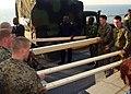 US Navy 100116-N-0000M-001 Members of Africa Partnership Station West and U.S. Marines move lumber on the flight deck of USS Gunston Hall (LSD 44).jpg