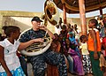 US Navy 100408-N-6138K-207 Musician 1st Class Roger Starcher performs for more than 300 children at the Colin Powell Cultural Center.jpg