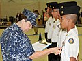 US Navy 100410-N-8848T-846 Senior Chief Yeoman Patricia Arnold measures the ribbons of a Navy Junior ROTC cadet from Centennial High School.jpg