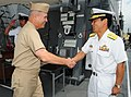 US Navy 100629-N-3570S-007 Japan Maritime Self-Defense Force Rear Adm. Kazuki Yamashita welcomes Vice Adm. Richard W. Hunt aboard the Japan Maritime Self-Defense Force guided-missile destroyer JS Atago (DDG 177).jpg