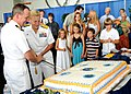 US Navy 100729-N-7908T-141 Rear Adm. Nora W. Tyson, commander of Carrier Strike Group (CSG) 2, cuts a cake with Capt. Jeffrey A. Hesterman after assuming command of the strike group.jpg