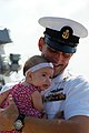 US Navy 100806-N-5292M-850 Chief Fire Controlman Kevin Prouty greets his niece during a homecoming celebration for the guided-missile destroyer USS Barry (DDG 52).jpg