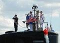 US Navy 100906-N-7705S-050 Cmdr. Douglas Jordan salutes as the ship returns to Naval Station Norfolk following a scheduled six-month deployment.jpg