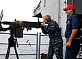US Navy 100925-N-6632S-286 Rear Adm. Nora Tyson, commander of Carrier Strike Group (CSG) 2, fires a .50-caliber machine gun.jpg