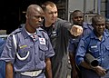 US Navy 110411-N-HI707-410 Hull Technician 1st Class Eric Bell instructs firefighting methods to members of the Nigerian naval police during a dama.jpg