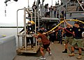 US Navy 110702-N-NJ145-413 Philippine media record the training while Philippine navy divers participate in a salvage exercise.jpg