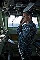 US Navy 110906-N-DX615-056 Capt. Jim Landers, commanding officer of the amphibious assault ship USS Makin Island (LHD 8), relays information via ph.jpg